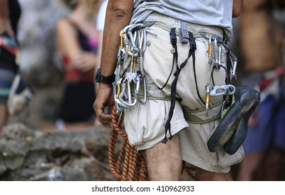 Climber with equipment on belt read for rock climbing