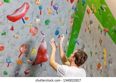 climber explores and develops a route on a climbing wall in the boulder hall