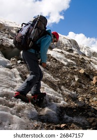 Climber girl in crampon moving on glacier