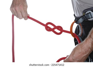 a climber is knotting a red rope