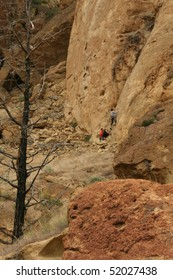 Climber on belay starts his ascent     at Smith Rock State Park, in Central Oregon