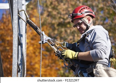 Climber on cell tower in autumn scennery