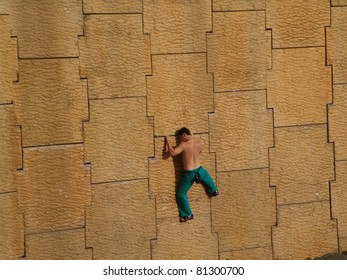 Climber on a concrete wall.