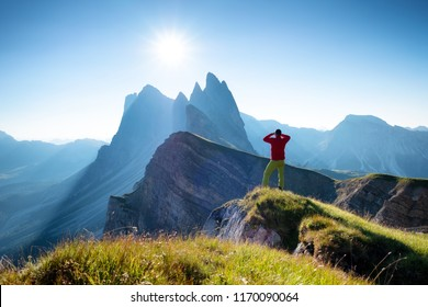 Climber on the high rocks background. Sport and active life concept. Adventure and travel in the mountain region in the Dolomites, Italy.