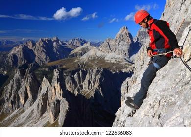 Climber on Merlone via ferrata, Dolomite Alps, Italy