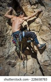 climber on the rock like a stone.