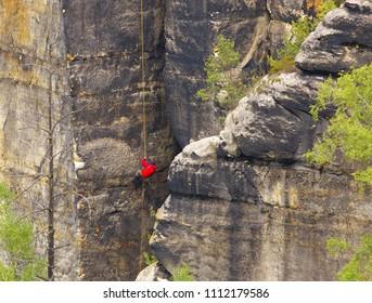 Climber on the rope, Saxony Switzerland, Germany