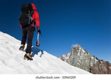 Climber on a snowy ridge, Grivola, west italian alps, Europe. Horizontal frame.