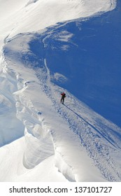 Climber on the snowy route to Mont Blanc sumit