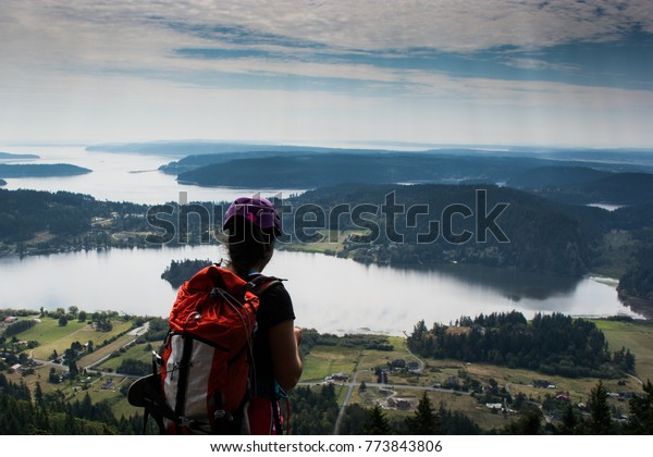 Climber on a summit east of the Pacific, North Cascades, Washington