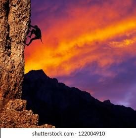 climber on sunset background