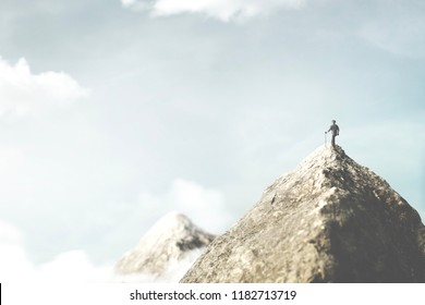 climber on the top of the mountain