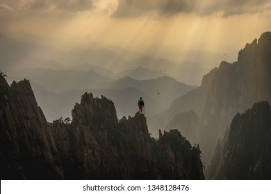 Climber on Top of a Mountain / China