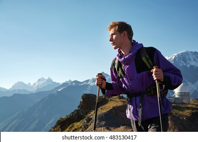 climber on trail in the mountains. a hiker in the mountain. Climb to the top. mountaineering