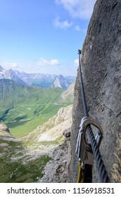 Climber on via ferrata, sella group, dolomites, italy