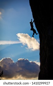 Climber on the wall  at sunset