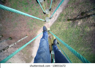 Climber passes a rope course, the view from the top down