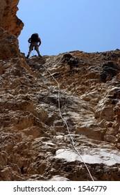Climber rapelling down