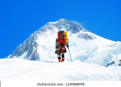 Climber reache the summit of mountain peak. Climber on the glacier. Success, freedom and happiness, achievement in mountains. Climbing sport concept.