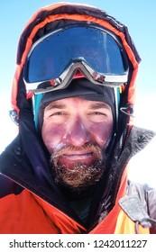1e28e93eb7 Climber reaches the summit of mountain peak. Success