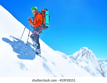 Climber reaches the summit of mountain peak. Climbing and mountaineering sport concept, Nepal Himalayas
