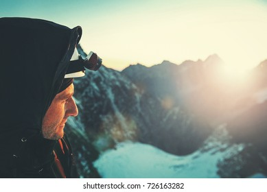 Climber  reaches the summit of mountain peak. Success, freedom and happiness, achievement in mountains. Climbing sport concept.