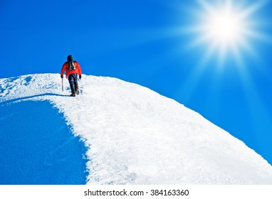 A climber reaching the summit. Extreme sport concept