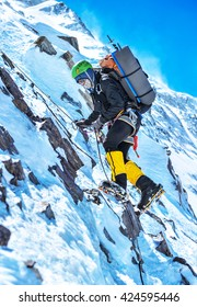 A climber reaching the summit of the mountain Everest
