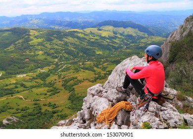 Climber resting after finishing the route and admiring the view
