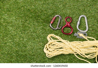climber safety device abandoned on green grass