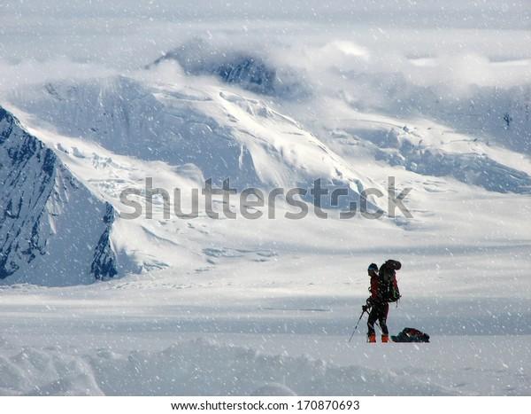 Climber in a snow storm ,Alaska