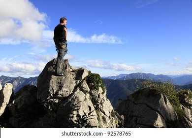 climber is standing on top of a mountain