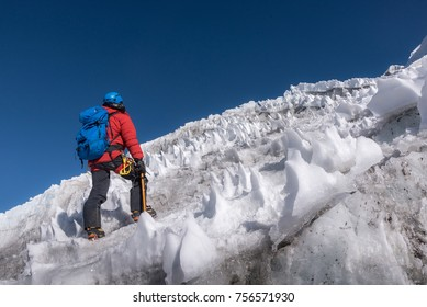 Climber walking up to the top of Lobuche East Neapal