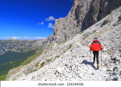 "Climber woman approaching via ferrata ""Passo Santner"", Catinaccio massif, Dolomite Alps, Italy"