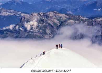 climbers climbing the mountain with mountain equipment, high mountain activity