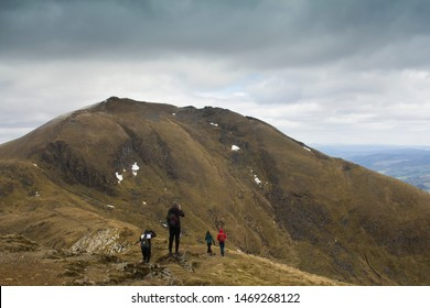 Climbers on Ben Lawers mountain in the Scottish Highlands on a wintery day