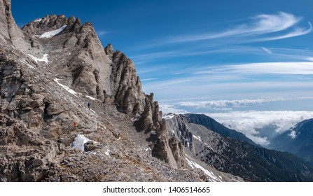 Climbers on the trail from Scala summit to Mytikas summit, the highest mountain of Olympus ridge in Greece. Climbing Mytikas summit.