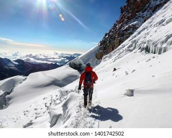 Climbing above 6,000 metres altitude to the summit of Huayna Potosi, Bolivia