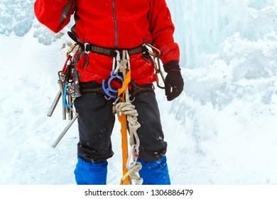 climbing equipment put on a climber close up