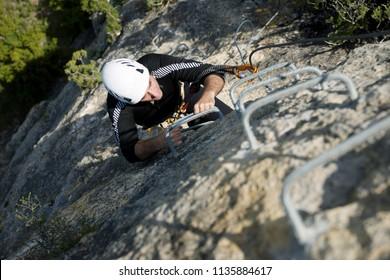 Climbing a Ferrata route in Calcena, Zaragoza Province, Aragon, Spain.