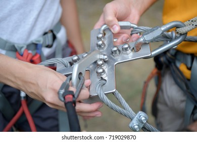 climbing gear attached to a female and male climbers harness