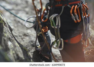 Climbing gear and equipment closeup. Tilt-Shift effect.