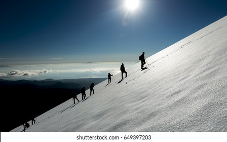climbing and hiking group in the snowy mountains