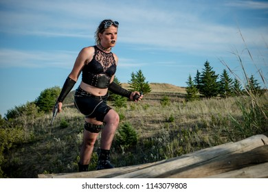 Climbing up the logs in the sprit cands national park. This woman is a punk rebel in a dystopian future