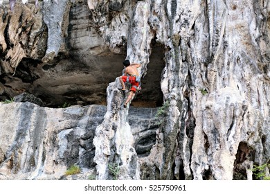 Climbing man woman thailand Ton Sai beach cliff rock extreme sports