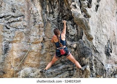 Climbing man woman thailand TonSai beach cliff rock extreme sports