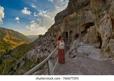 Climbing multiple steps of famous Vardzia Cave city in Georgia