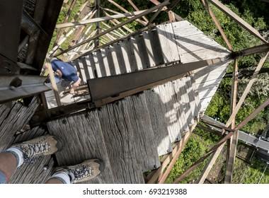 Climbing an old fire tower steps.