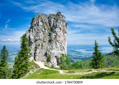 climbing rock on the Kampenwand, a famous mountain in Bavaria, view to the Chiemsee