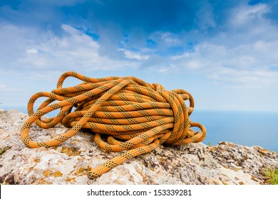 Climbing Rope coiled up and placed on the rock